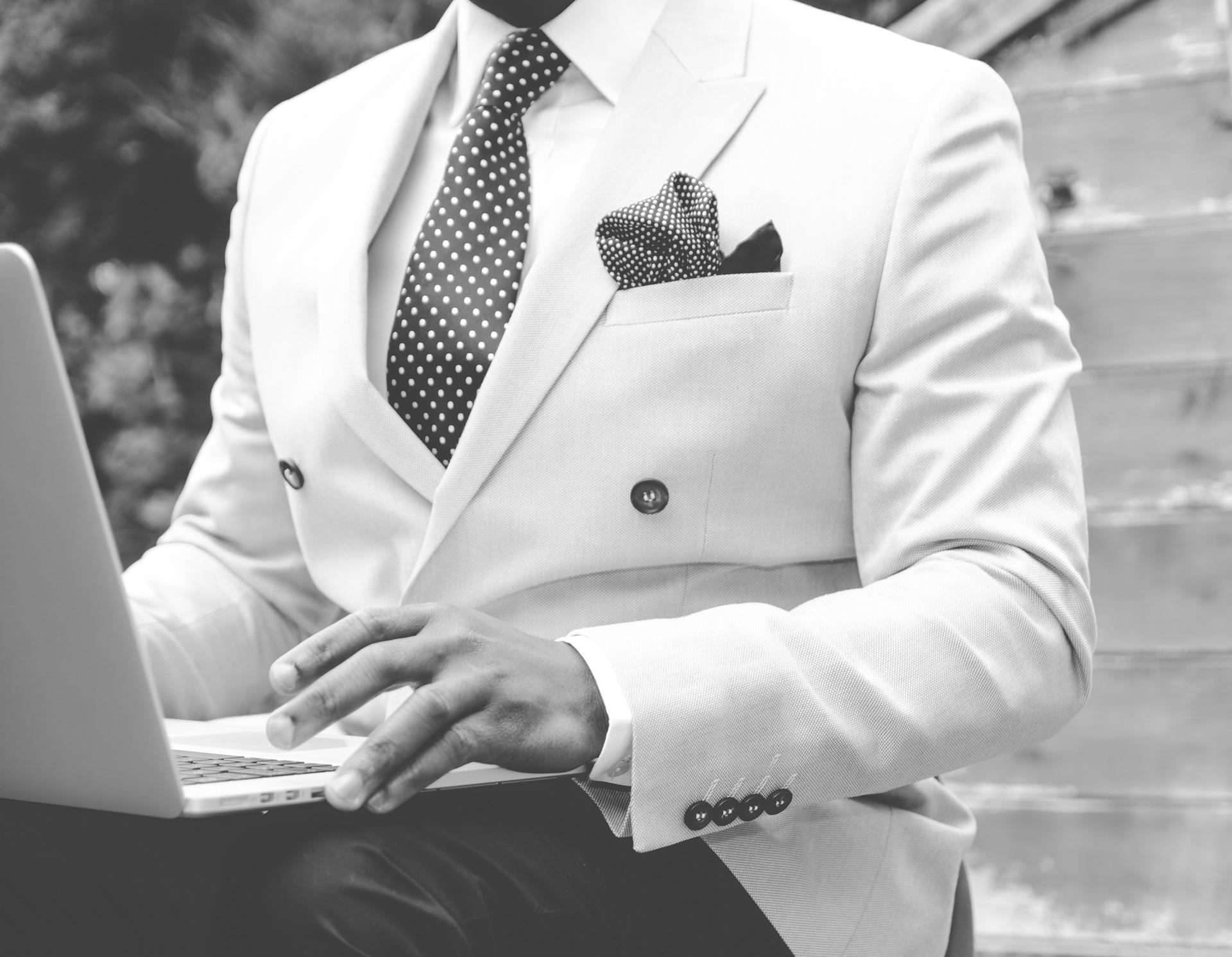 Enterpreneur in suit, working away from home